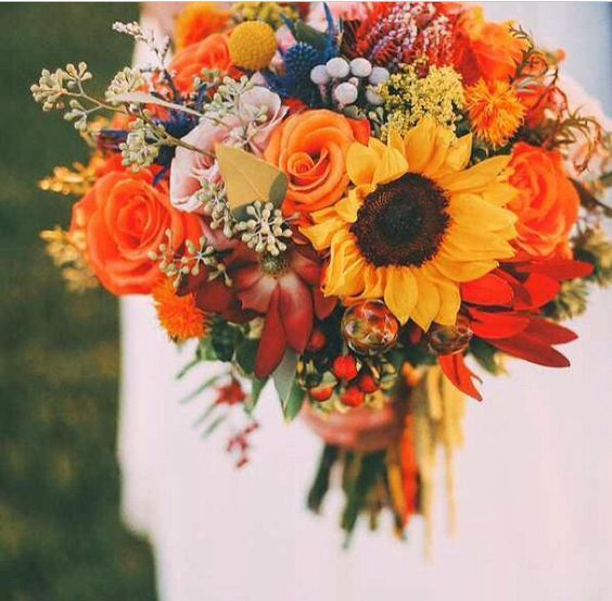 orange roses sunflowers fall wedding bouquet / http://www.himisspuff.com/country-sunflower-wedding-ideas/14/