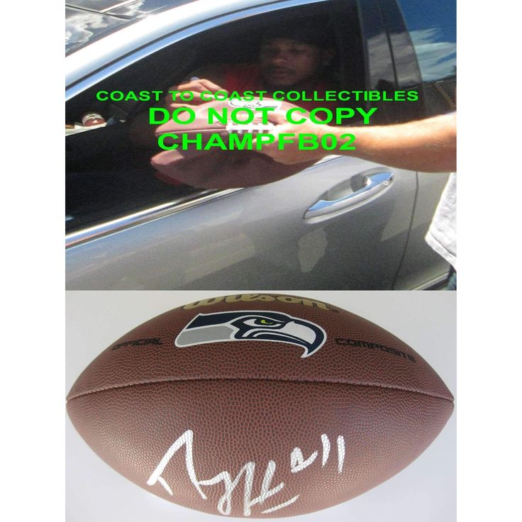 Percy Harvin, Seattle Seahawks, Signed, Autographed, NFL Logo Football, a COA with the Proof Photo of Percy Signing Will Be Included with the Football