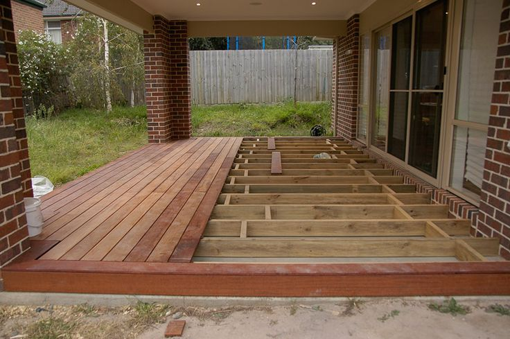 Maybe we should try a deck over our concrete patio? It'd be a lot less dusty