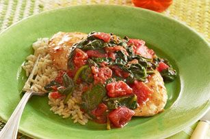 Chicken comes out extra tender after a skillet-simmer with diced tomatoes and spinach. They'll never believe you made this main dish chicken recipe in minutes.