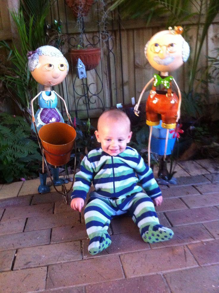 Mitchell with Nanny & Poppy's new garden planters.