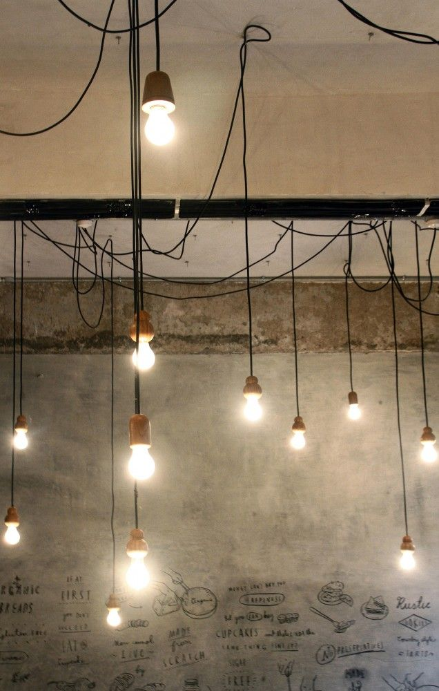 Industrial style lighting.  Birdsong Cafe / Studio Eight Twentythree
