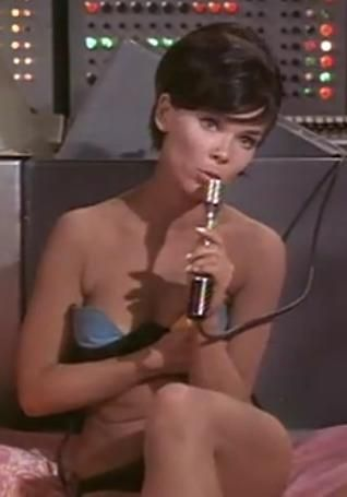 Yvonne Craig in The Man from Uncle (1965) -- here she's operating the communications system while sun-tanning topless.  Let's them try that in The Wire.