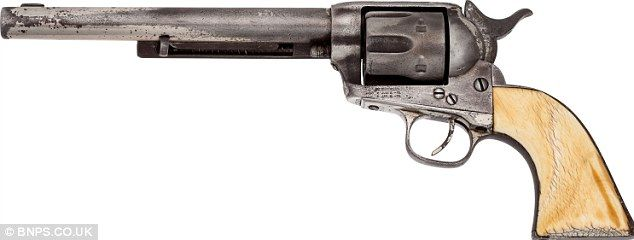 Jesse James' Colt .45 revolver expected to fetch $1.6million at auction 130 years after outlaw's assassination