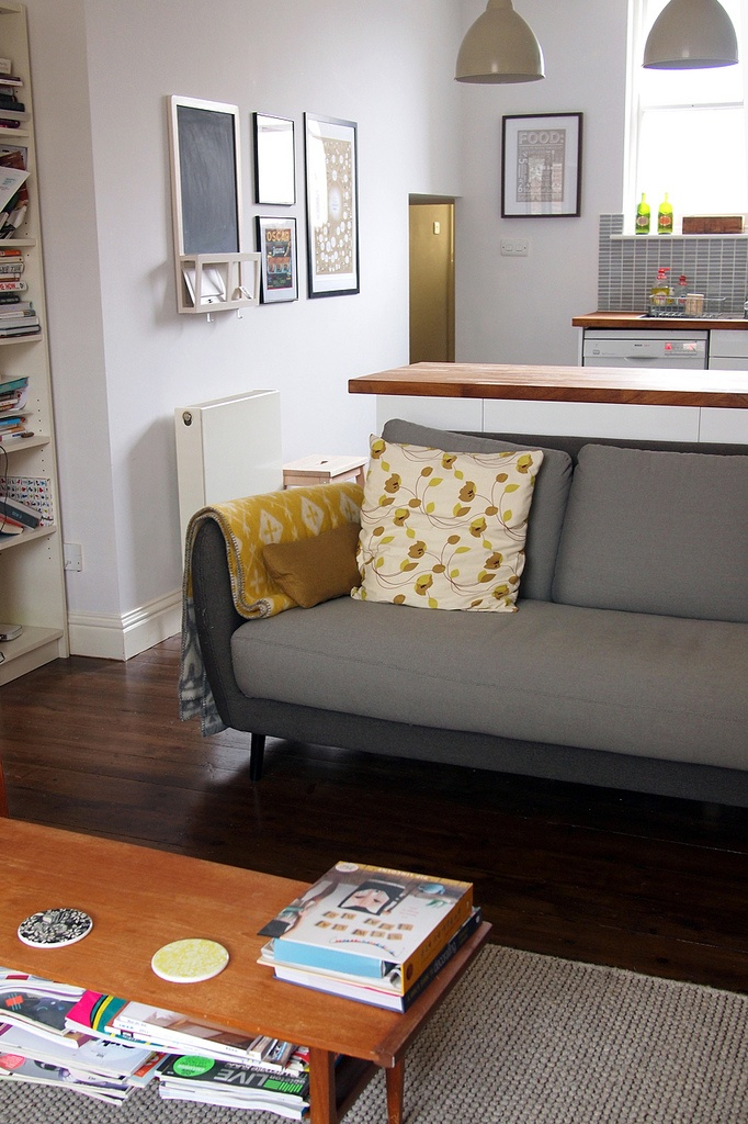 Good living room in a London flat (yellow and grey)