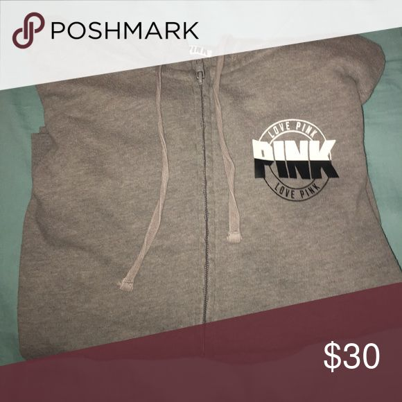 A pink zip up hoodie The jacket is gray with a black and white logo PINK Victoria's Secret Jackets & Coats