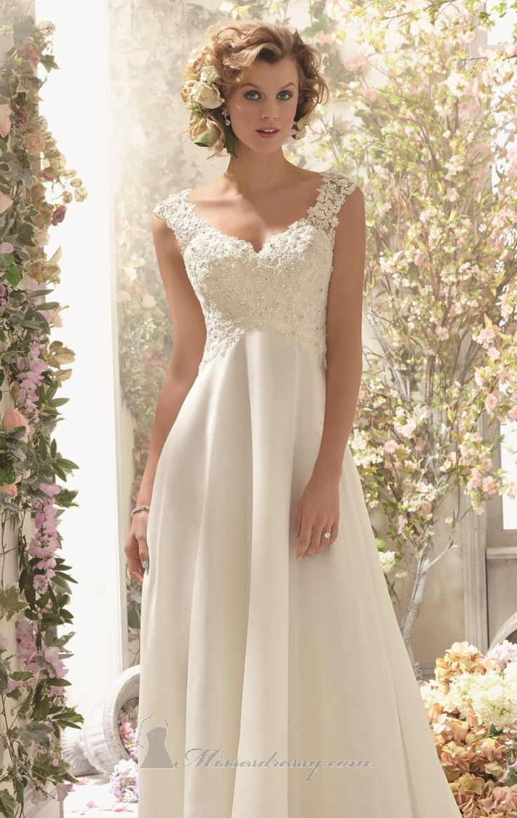 Imagine the radiant bride you will be in 6778 by Voyage by Mori Lee. This flowing empire wedding gown is made of Alencon lace and chiffon. T...