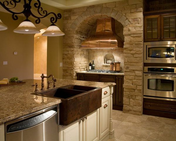 Tuscan Style Kitchen Design with Cooper Hood and Farm Sink