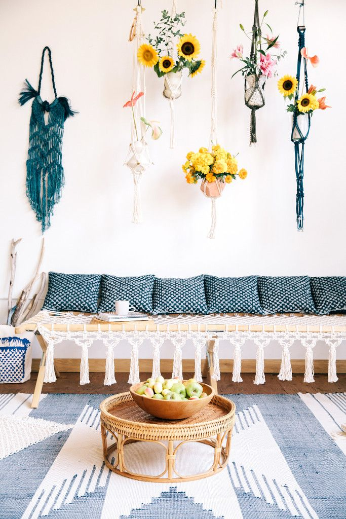 A foldable wooden frame cot with cotton rope seating and tassels! For inside use* Buy now to add this amazing statement piece to your boho jungalow!