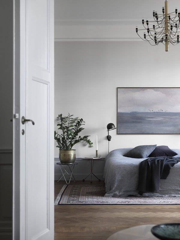 Tour a Moody, Gray Stockholm Apartment With Period Details