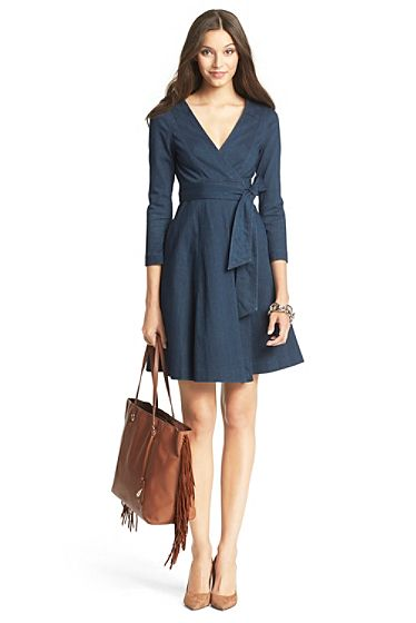 This is a DVF 3/4 length sleeve indigo wrap dress with bow detail belt. It is a simple silhouette and style.