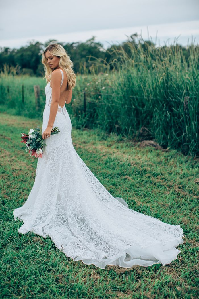 Flowing Lace Dress with a Low Back from Made With Love Bridal