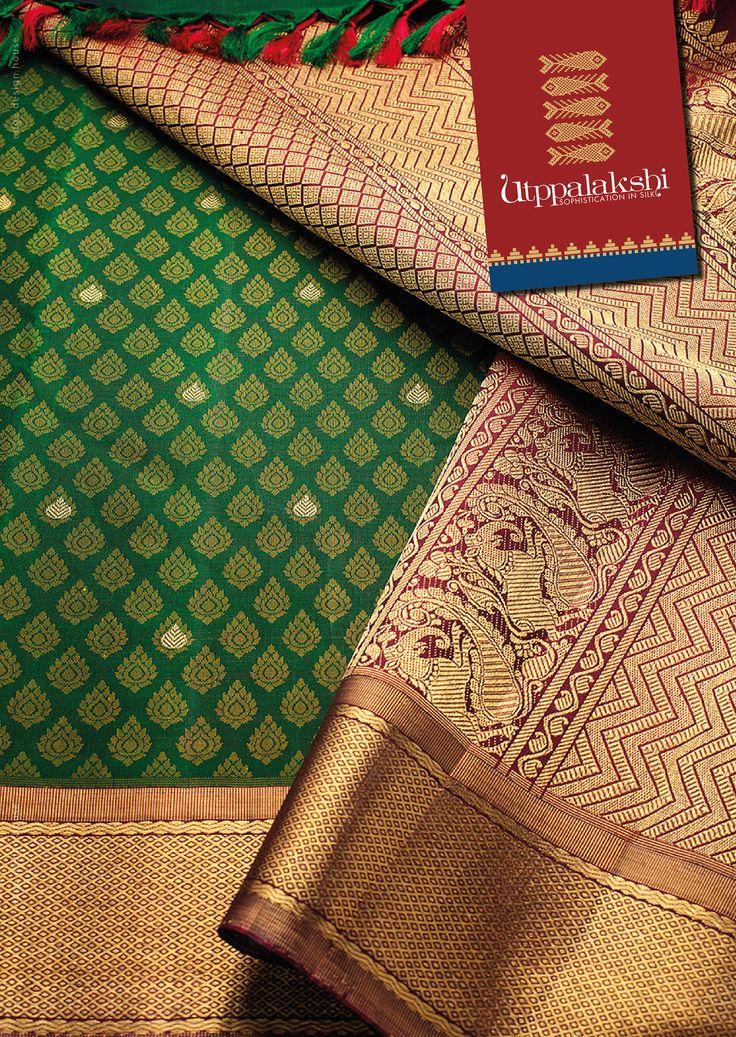 Bottle green Utppada saree with maroon border. The gold butties highlight the subdued motifs. The yazhis in pallu of the saree is beautifully woven. Very Regal. #Utppalakshi #Sareeoftheday#Silksaree#Kancheevaramsilksaree#Kanchipuramsilks #Ethinc#Indian #traditional #dress#wedding #silk #saree#craftsmanship #weaving#Chennai #boutique #vibrant#exquisit #pure #weddingsaree#sareedesign #colorful #elite