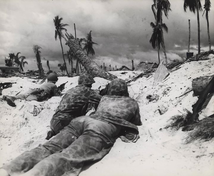 US Marines in prone position on the landing beach at Tarawa Gilbert Islands 20 November 1943.