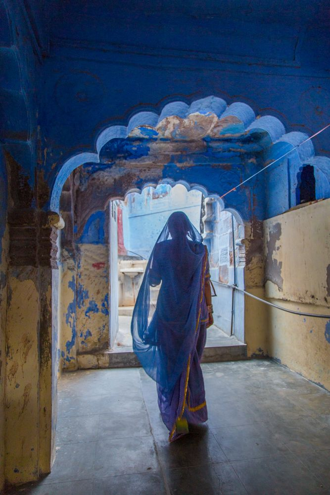 Places to go in India: Jodhpur: A woman in blue walks through an archway the blue city