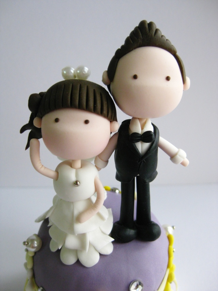 wedding clay cake topper - standing on top of a cake