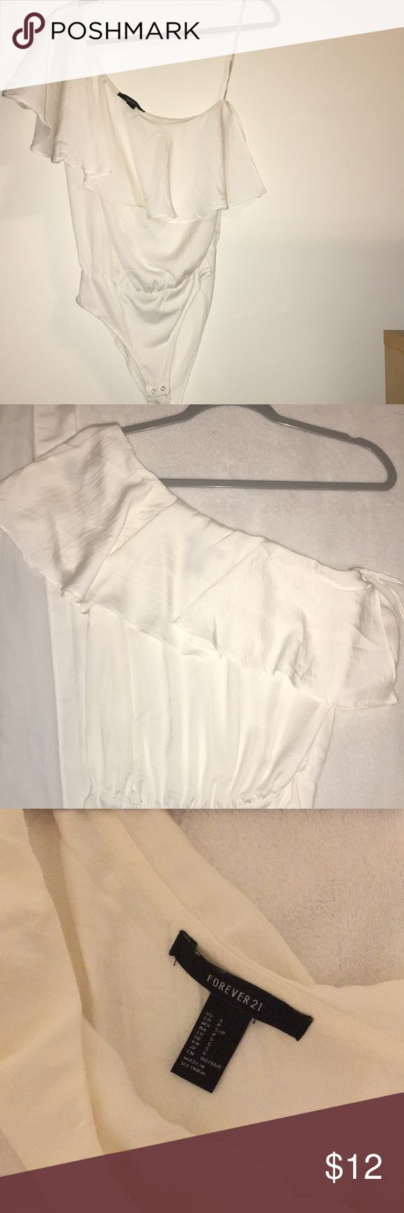 White silk one-shoulder bodysuit ☁️🕊 Forever 21 'silk' body suit. Off the shoulder, with a frill skirt. Zipper on the side, size small. The color is egg shell white Forever 21 Tops
