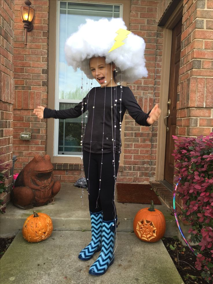 Rain Cloud Halloween Costume 2015. We attached poly fill to a novelty cowboy hat with a glue gun for the cloud. For the rain we threaded silver sequins and clear beads onto clear stretch and purple metallic threads then we hot glue those to the brim of the hat. We glued yellow construction paper to light chipboard and cut out the lightning bolt for a dash of color. Add fun galoshes and voila!
