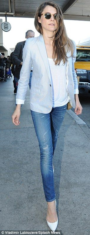 Slim pins: The actress accentuated her trim legs in a pair of skinny jeans and white pointed-toe pumps