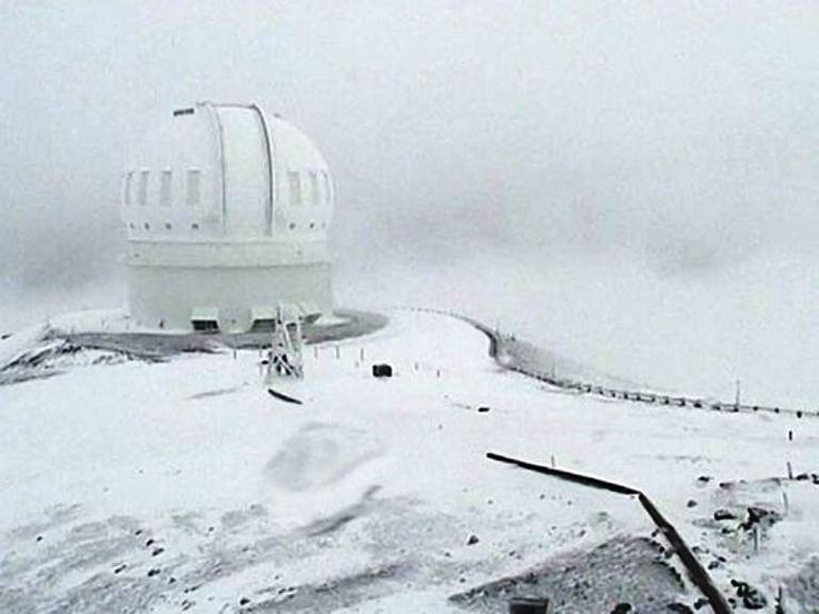 The Canada-France-Hawaii Telescope on the summit of Mauna Kea On Hawaii's Big Island is covered in snow on December 1, 2016.  The National Weather Service in Honolulu has issued a winter storm warning for the summits of Hawaii's Big Island as wind and snow engulf the high peaks.  (Photo:  Canada-France-Hawaii Telescope, AP)  http://www.usatoday.com/story/news/nation/2016/12/02/up-foot-snow-forecast-summits-hawaiis-big-island/94800450/