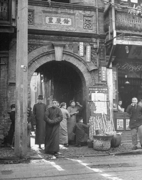 A customer leaving an opium den. Photograph by George Lacks. Mukden, China, March 1946.