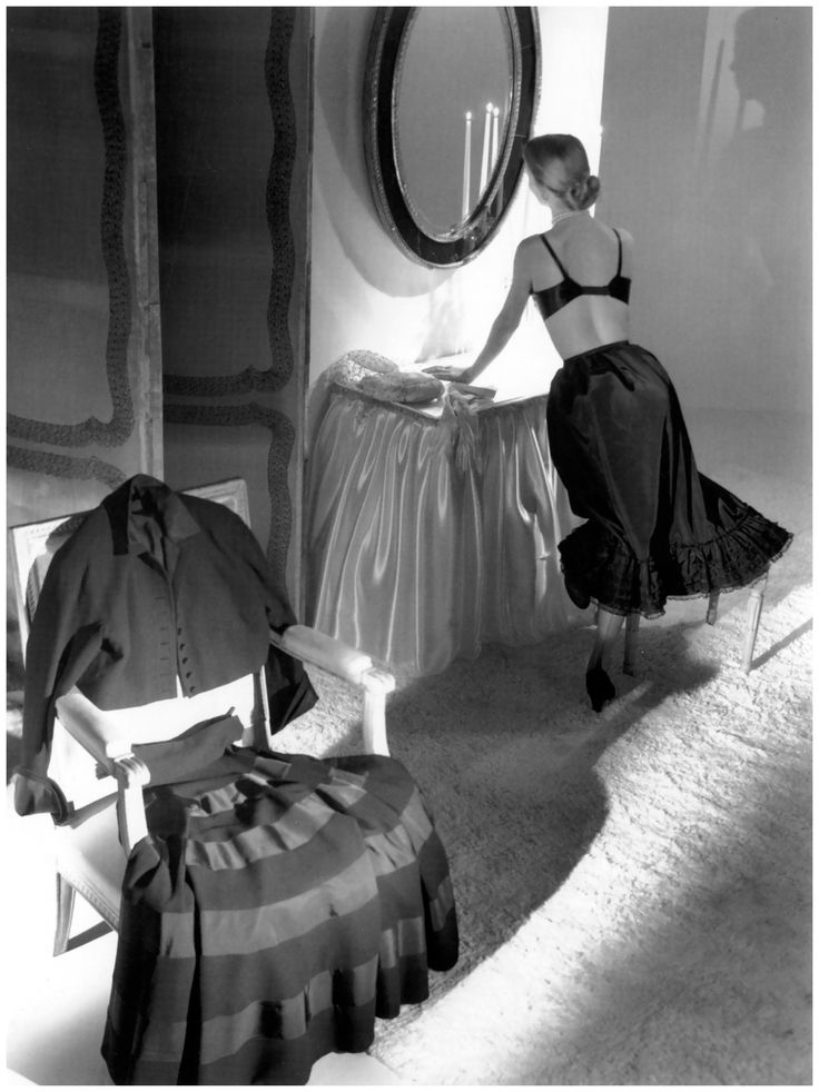 A woman getting dressed, 1947. Image by Horst P. Horst. #vintage #1940s #fashion