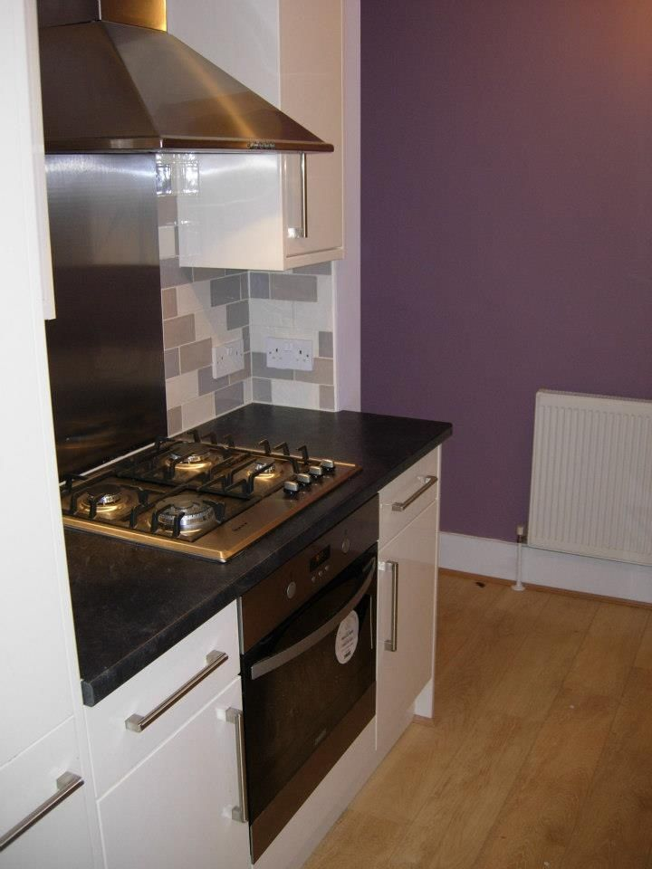 Stainless steel hob, oven and extractor give this a contemporary feel and enhanced with plain walls in a mid purple. http://www.ppmsltd.co.uk