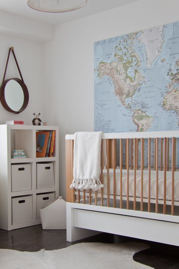 love the map on the wall in this nursery