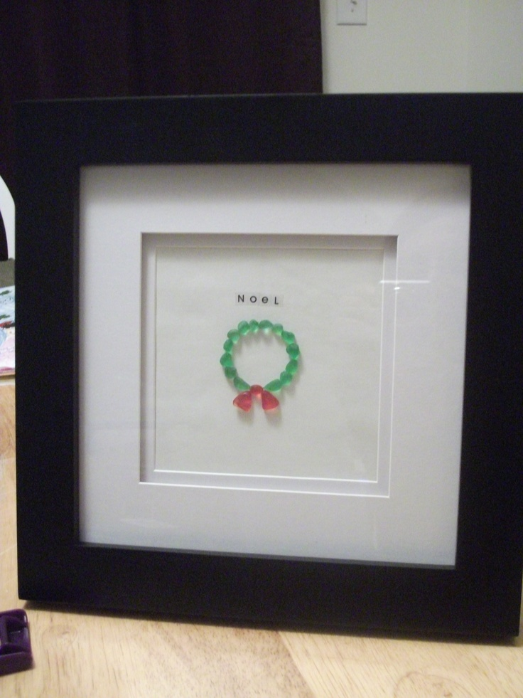Framed and double matted wreath picture with green and rare red beach glass. Noel!