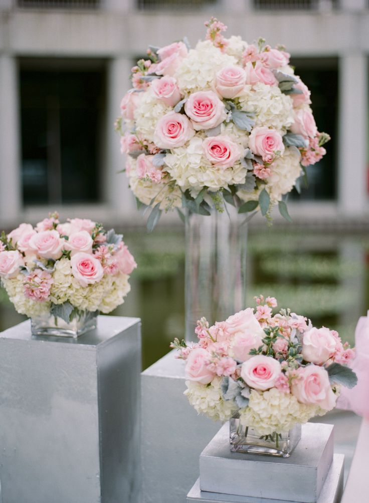 Pink rose, white hydrangea and dusty miller arrangements