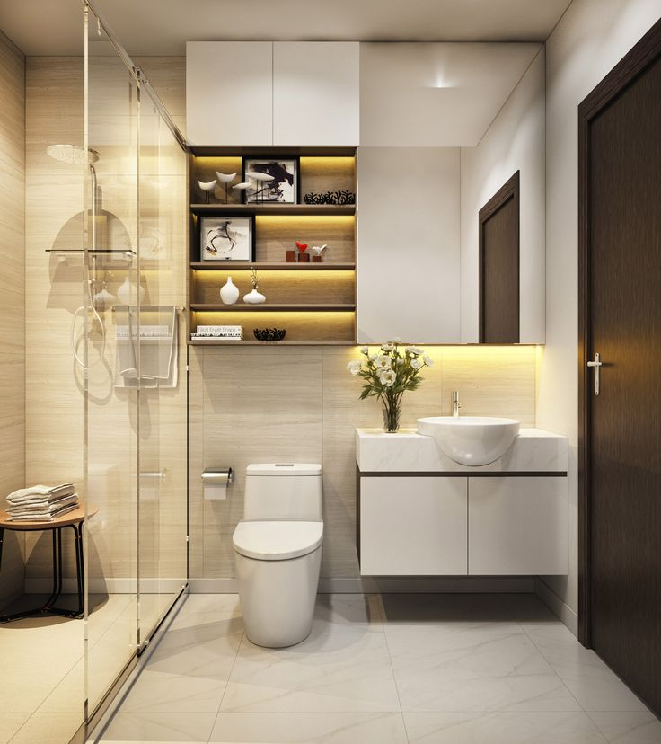 This compact bathroom seems spacious with the use of glass and light tiled flooring and textured walls. The sink seems to be sitting in the marble countertop. A lighted cabinet above gives space for display or storage.