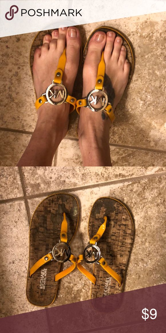 Michael Kors orange flip flops Size 7 Used flip flops in size 7. They have been loved but lots of life left in them! Feel free to comment with questions. Thank you! Michael Kors Shoes Sandals