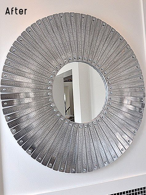 A mirror made of metal rulers. So chic