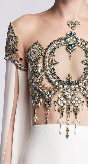 Reem Acra....OMG, beautiful. Change to fit the wedding theme or colors. Work within the budget.
