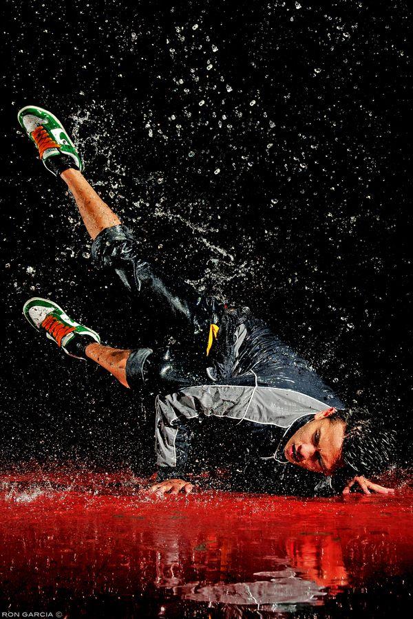 high speed photo of a break dancer in water
