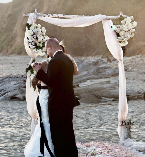 Birch beach wedding arch arbor on beach.