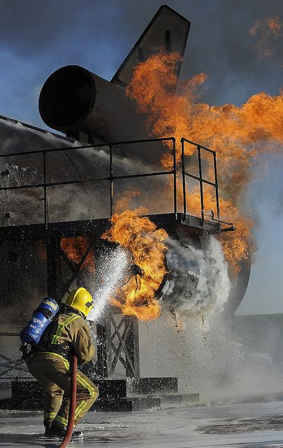 A Royal Air Force Firefighter tackles flames and heat at the multi-simulator training unit at the Defence Fire Training and Development Centre, Manston.