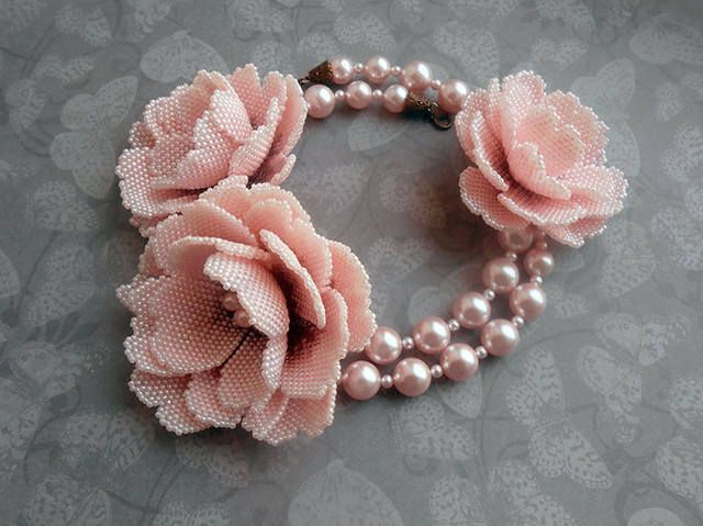 Bead roses on a very elegant necklace. There's also a pattern for the petals, in brick stitch (I think).