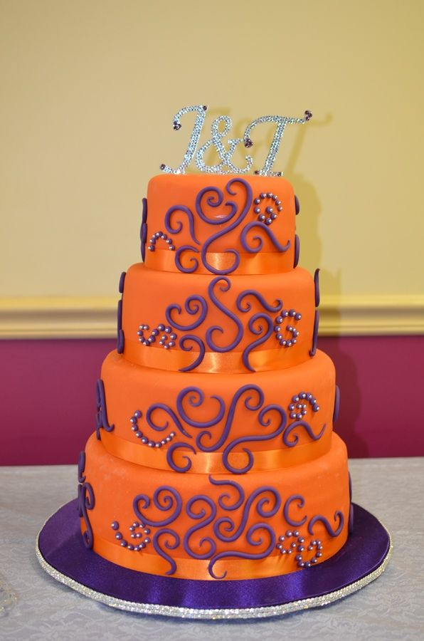 "4 tier wedding cake, Orange with purple and silver accents. Tiers are 12"", 10"", 8"" and 6"", each about 4"" tall. Adap..."