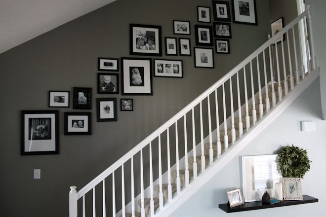 This is exactly what I want to do going up our stairs. Except, I'll mix color and bw photos like on the wall behind my couch.