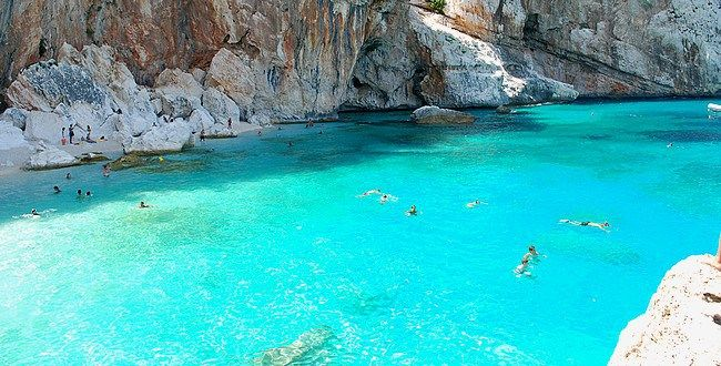 Cala Gonone, Sardinia  This small town in Sardinia, Italy has some fantastic beaches to explore and often you can enjoy them almost entirely to yourself. With the crystal clear waters and that hot Italian sun, there's hardly any reason not to come!