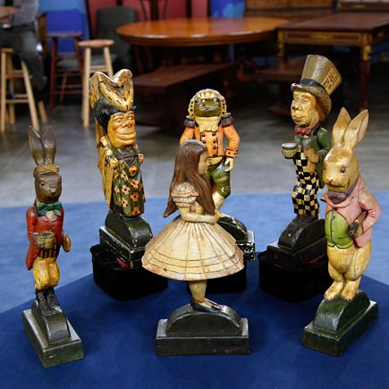Possibly one of a kind carved wood on metal base Alice in Wonderland doorstops.  I've never wanted anything (as far as a possession goes) like I've wanted these since I saw them on Antique Roadshow!  OMG