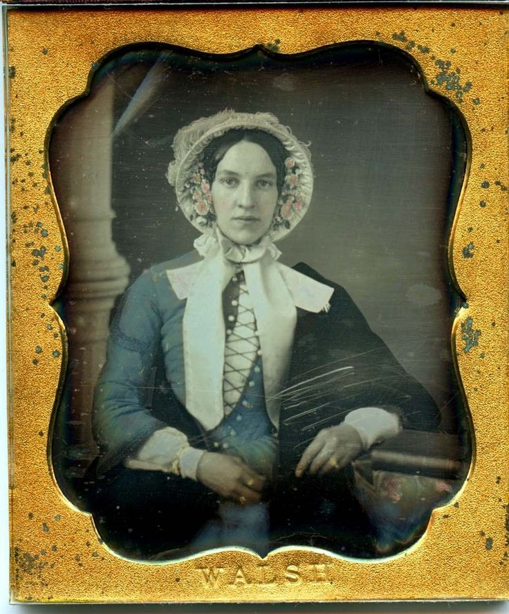 A 1/6 plate daguerreotype by WALSH of a stylish lady in a blue dress and bonnet