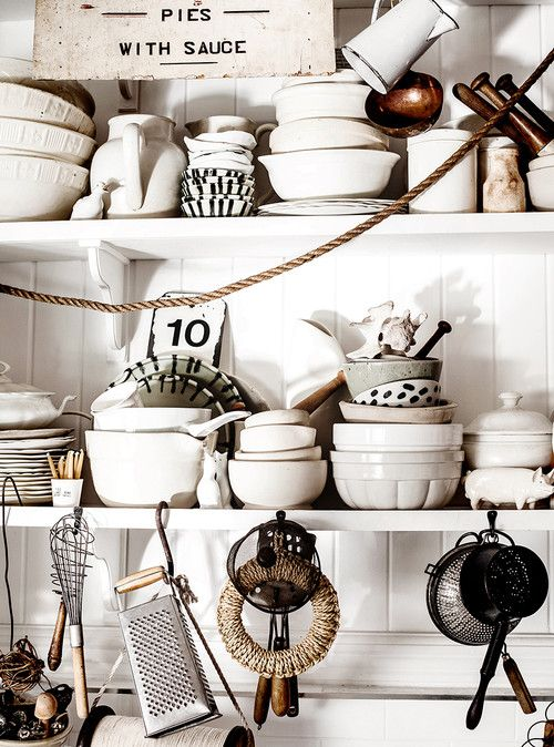 White Bowls and Cookware in Eclectic Kitchen