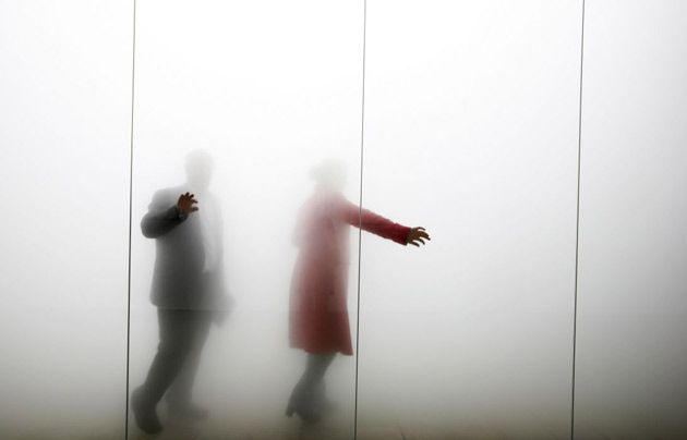 Credit: David Levene/Guardian Visitors explore Gormley's Blind Light installation. Oscillating ultrasonic humidifiers create a dense vapour reducing the visibility inside the eight by 10 metre glass enclosure.