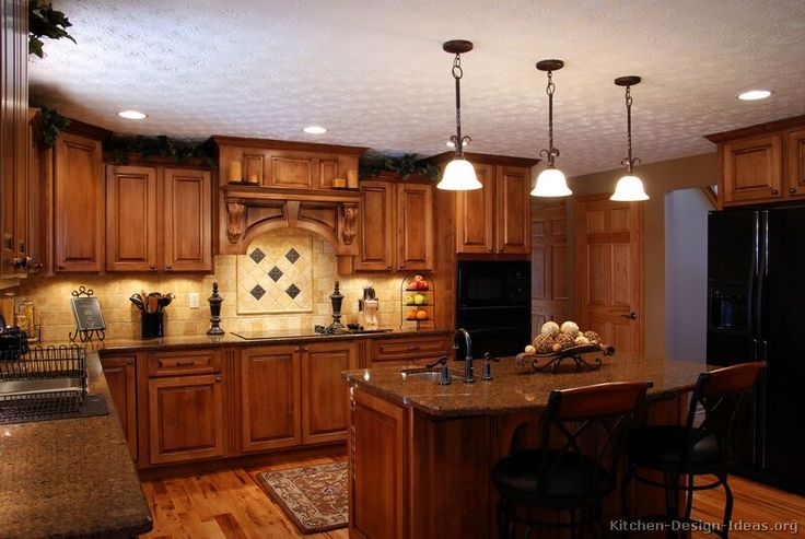 #Kitchen of the Day: A warm Tuscan kitchen with rich golden-brown cabinets, pendant lights, and a wood hood - # 09 (Kitchen-Design-Ideas.org)