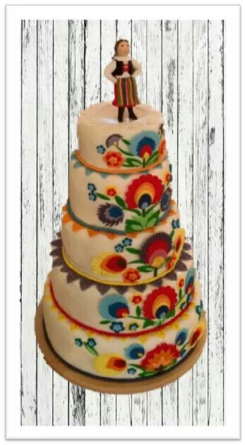 "Folklore inspired cake. Add a pair of traditional Polish dancers on the top for a cute, unique, wedding cake. Cake by ""Dekorello"" from Łódź,Poland. Image taken from their Facebook page. Also found at http://www.dekorello.com.pl/"