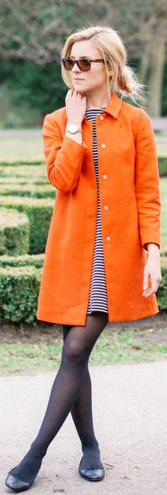 Katarzyna Tusk is wearing an orange coat from Benetton