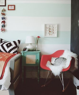 Coral chair and mint striped wall