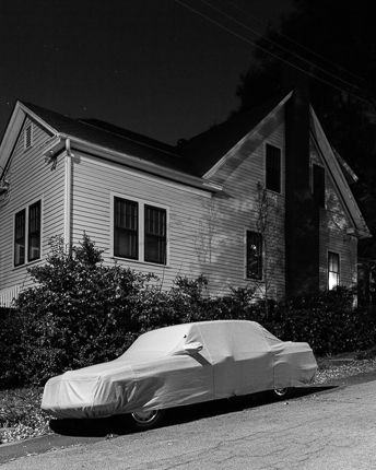 Adam Bellefeuil --------- lone car, covered. high contrast. a sense of mystery that is somewhat haunting